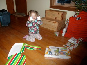 Mimi holding one of her Christmas presents. Yes, it is tape. She asked for tape. Did you see her Christmas list?