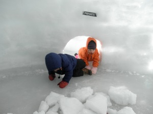 The kids were nervous and not pleased about trucking across the lake that day (it was cold and really hard to walk on the ice) but once they hit the igloo, they were all about it.