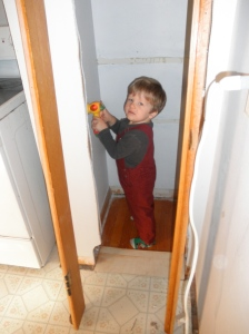 """My awesome husband is building us a pantry; Orin likes to get out his hammer to """"help"""""""