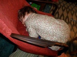 Awww, little man wasn't feeling well and fell asleep on the chair.