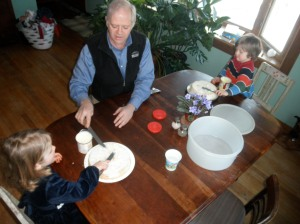 A well-timed visit from Pops and Gra-Gra while Andy was traveling. Here they are frosting a cake together.